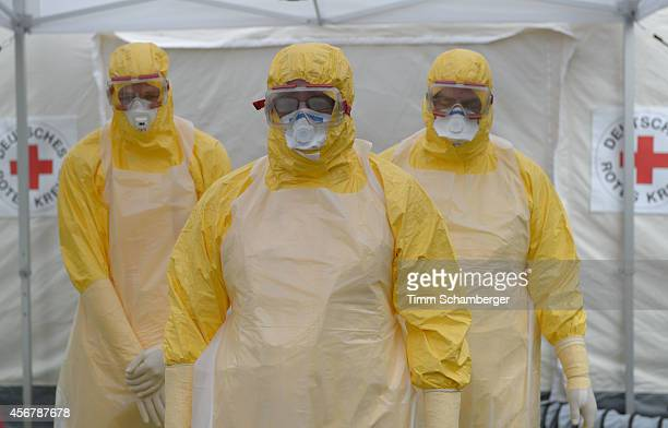 Volunteer doctors who will travel to West Africa to help care for Ebola patients waiting for desinfection during training offered by the German Red...