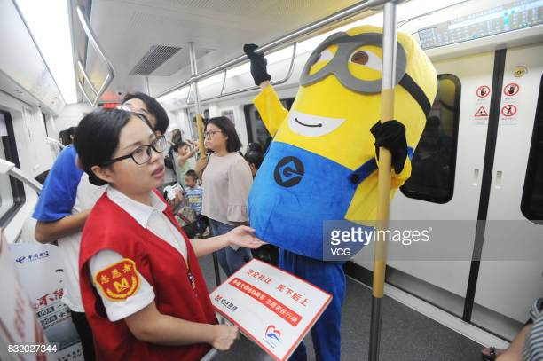 A volunteer dressed as Minions character greets members of the public at the Wuhan Metro line 3 on August 13 2017 in Wuhan Hubei Province of China...