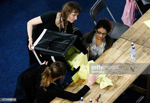 A volunteer empties a ballot box onto a table for votes to be counted inside the English Institute of Sport including ballot papers for the...