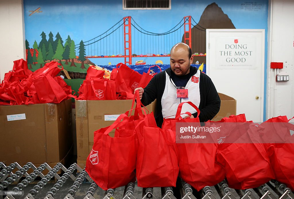 A volunteer fills bags with food during the Salvation Army's Toy & Joy Shop Distribution on December 20, 2012 in San Francisco, California. With less than one week before Christmas, the Salvation Army's Golden State division held a Toy & Joy Shop Distribution event that allows families in need to shop for free toys and receive a bag with ingredients to make a holiday meal. Nearly 1,500 families will attend the two day event.