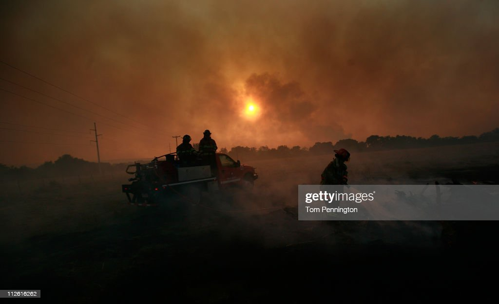 Volunteer firefighters battle a running wildfire on April 19, 2011 in Graford, Texas. Dozens of area homes have been destroyed in the wildfires that have been fueled by dry conditions, high winds, and low humidity.