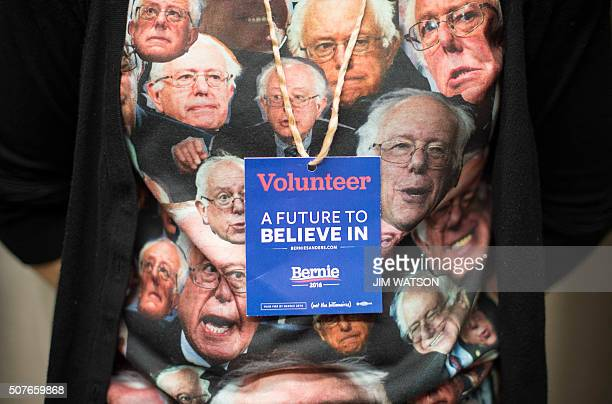 A volunteer for the Democratic presidential candidate Bernie Sanders campaign listens as Sanders speaks at the University of Iowa in Iowa City Iowa...