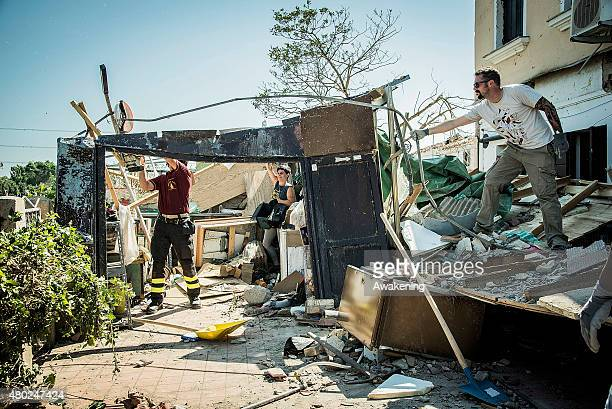 A volunteer from 'Centri Sociali Nord Est' helps in clearing the damage caused by the tornado on July 10 2015 in Venice Italy One person died 87...