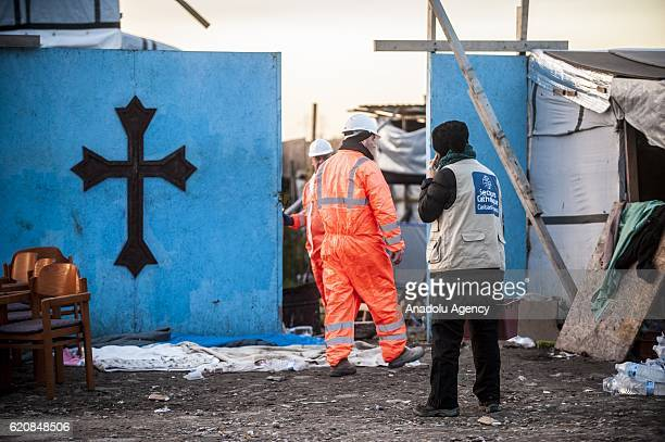 A volunteer from the 'Catholic Relief' observed the destruction of the Eritrean church last place of worship of the jungle by workers in Calais on...