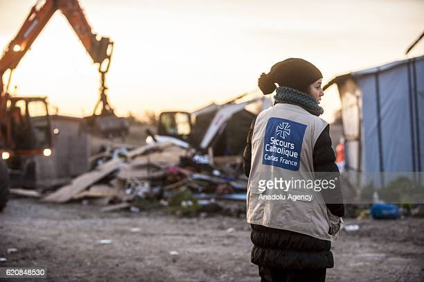 A volunteer from the 'Catholic Relief' observes the destruction of the Eritrean church last place of worship of the jungle in Calais on November 3...
