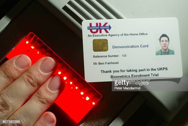 A volunteer has his fingerprints scanned for a biometrics enrolment card in British Passport Office London England April 24 2004