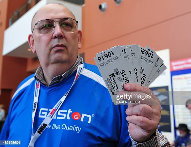 A volunteer hawks raffle tickets for the wall of guns at the 2015 NRA Annual Convention in Nashville Tennessee on April 10 2015 Twenty dollars gives...