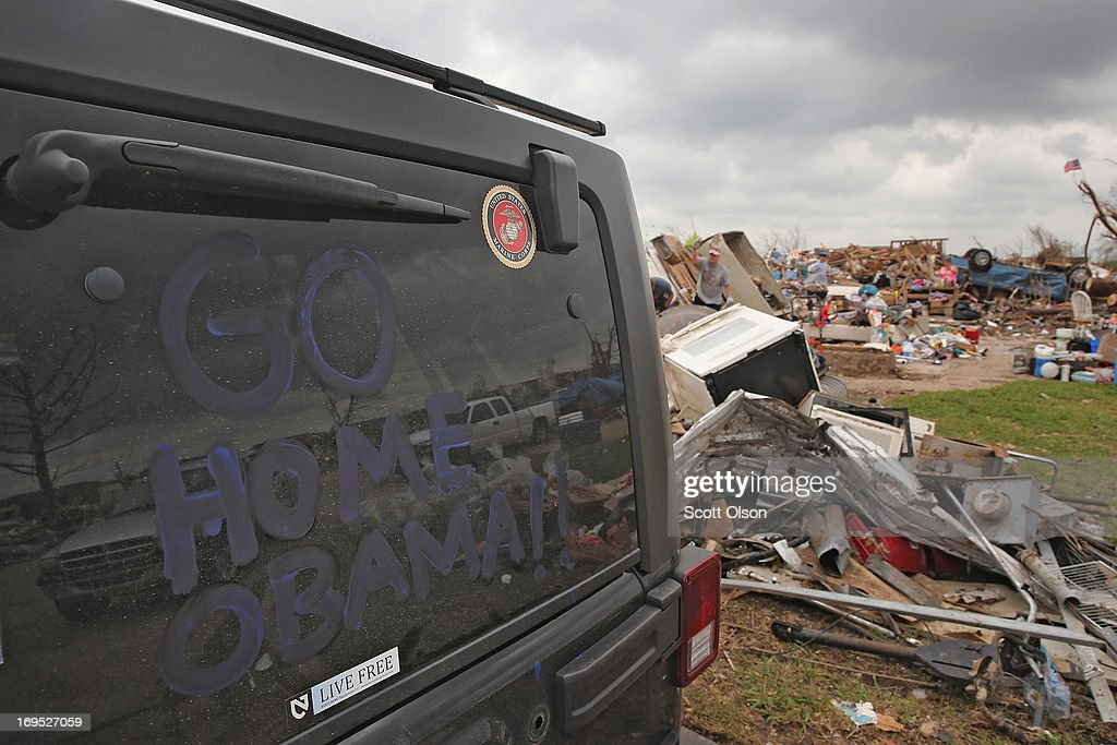 A volunteer helping with the cleanup effort and former U.S. Marine displays his views of President Barack Obama on the window of his Jeep while the president toured the tornado-damaged area nearby May 26, 2013 in Moore, Oklahoma. U.S. President Barack Obama toured Plaza Towers Elementary School where 7 children were killed by the May 20 tornado during his visit to Moore.