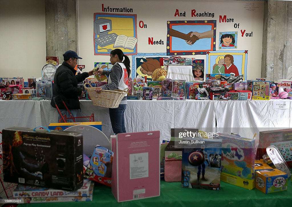 A volunteer (R) helps a man shop for toys during the Salvation Army's Toy & Joy Shop Distribution on December 20, 2012 in San Francisco, California. With less than one week before Christmas, the Salvation Army's Golden State division held a Toy & Joy Shop Distribution event that allows families in need to shop for free toys and receive a bag with ingredients to make a holiday meal. Nearly 1,500 families will attend the two day event.