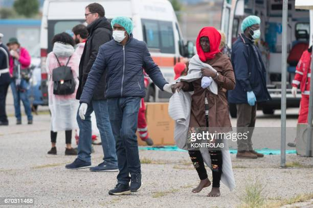 PORT CORIGLIANO CALABRIA ITALY A volunteer helps a migrant during the landing from the vessel Vos Hestia of Save The Children in the port of...