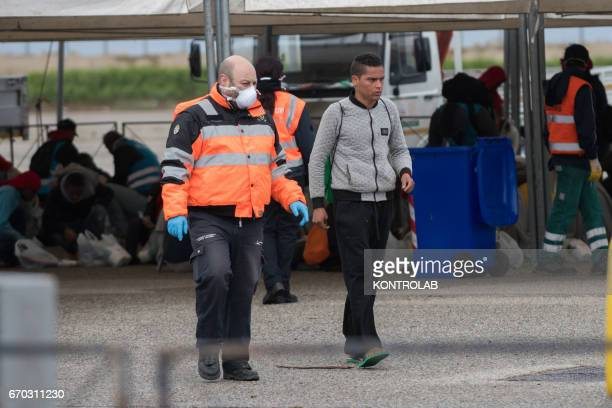 PORT CORIGLIANO CALABRIA ITALY A volunteer helps a migrant unaccompanied minor during the landing from the vessel Vos Hestia of Save The Children in...