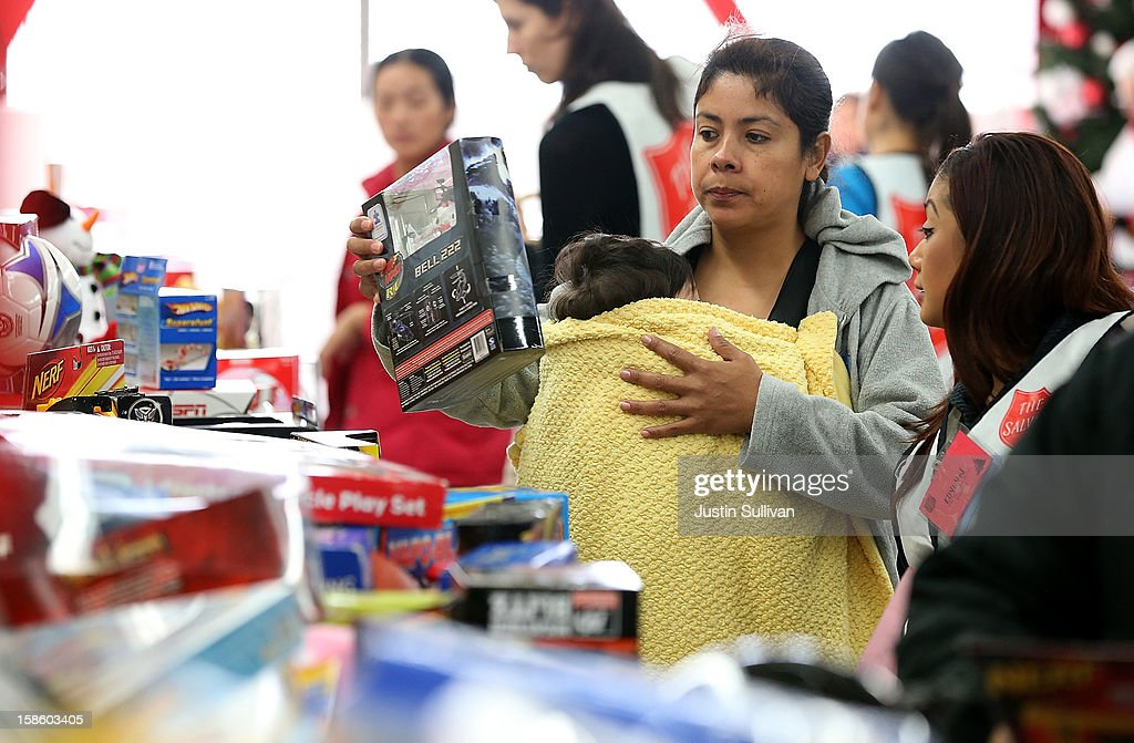 A volunteer (R) helps a woman shop for toys during the Salvation Army's Toy & Joy Shop Distribution on December 20, 2012 in San Francisco, California. With less than one week before Christmas, the Salvation Army's Golden State division held a Toy & Joy Shop Distribution event that allows families in need to shop for free toys and receive a bag with ingredients to make a holiday meal. Nearly 1,500 families will attend the two day event.