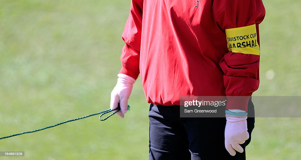 A volunteer holds a rope during the second day of the Tavistock Cup at the Isleworth Golf and Country Club on March 26, 2013 in Windermere, Florida.