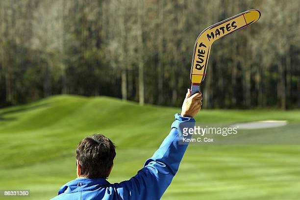 A volunteer holds up a quiet sign in the shape of a boomerang during the second round of the 2007 Outback Steakhouse ProAm Saturday February 17 at...