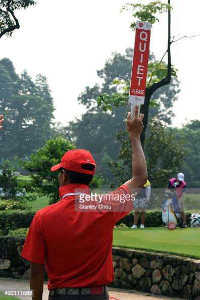 A volunteer holds up a quiet sign on the 4th hole during round three of the Sime Darby LPGA Tour at Kuala Lumpur Golf Country Club on October 10 2015...