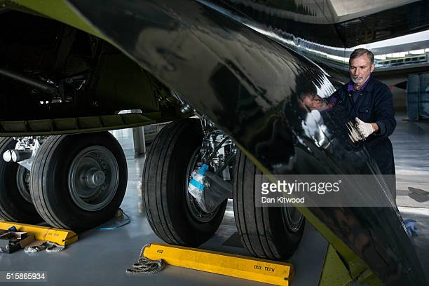 Volunteer Ian cleans the undercarriage of a B52Stratofortress inside the newly refurbished 'American Hanger' at the Imperial War Museum in Duxford on...