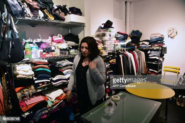 Volunteer Jenny Tapia works at a 'boutique' that gives away donated crisp business clothes to those who on Mexico's September 19 quake lost...