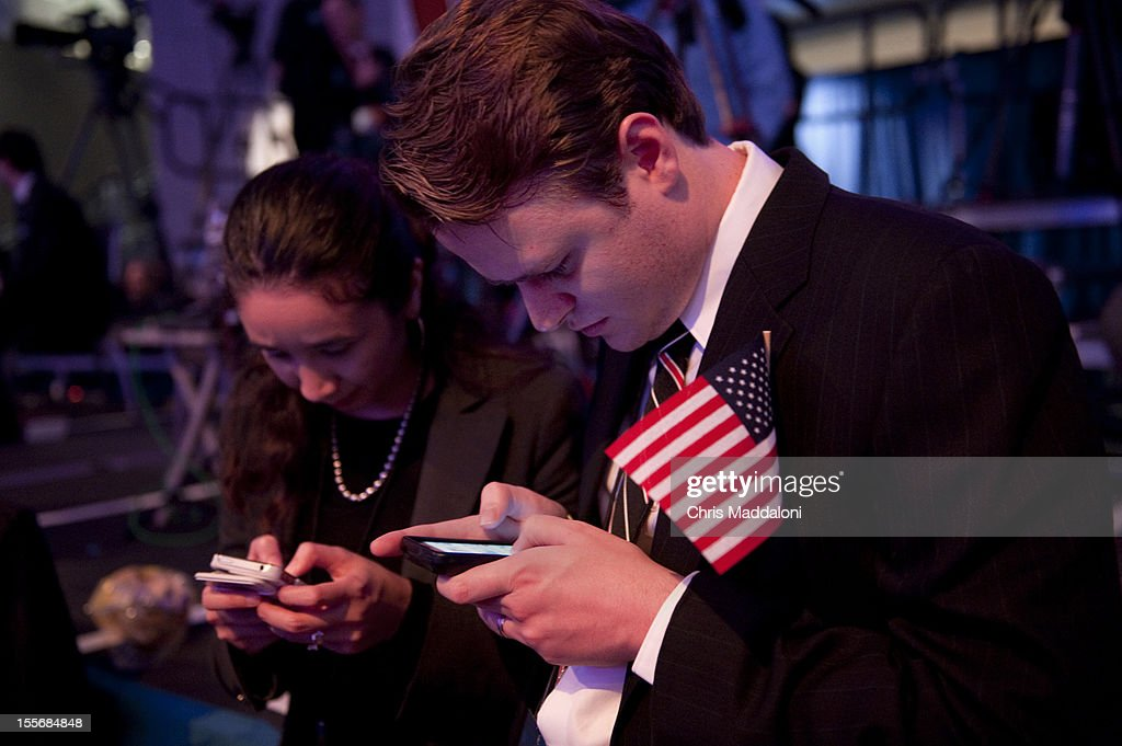 Volunteer John Kelly checks for results on his phone at the Republican National Committee Election Night party at the Ronald Reagan Building in Washington, DC.