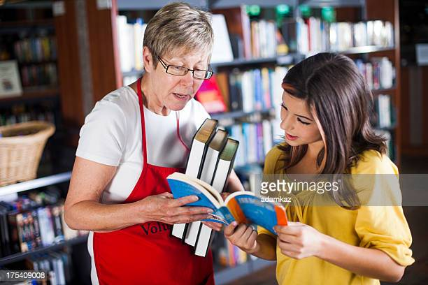 Volunteer Librarian Helping Student