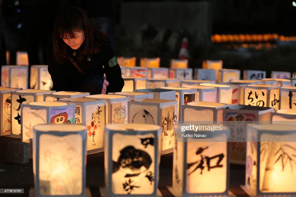 A volunteer looks at paper lanterns during a memorial held in remembrance of victims of the March 11, 2011 earthquake and tsunami at Yuriage Junior High School on March 11, 2014 in Natori, Miyagi prefecture, Japan. On March 11 Japan commemorates the third anniversary of the magnitude 9.0 earthquake and tsunami that claimed more than 18,000 lives, and subsequent nuclear disaster at the Fukushima Daiichi Nuclear Power Plant.