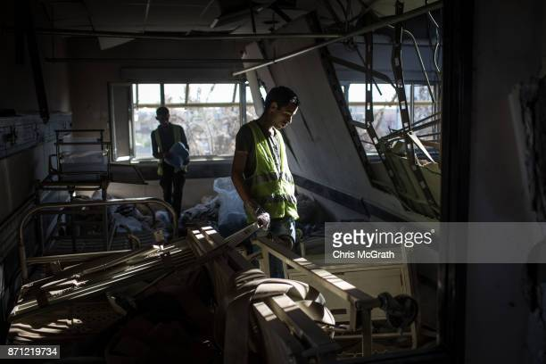 A volunteer looks for useful medical items inside the destroyed Salam Hospital on November 5 2017 in Mosul Iraq Salam Hospital Mosul's main hosptal...