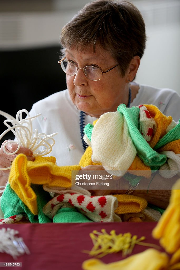 Volunteer Mary Russell strings together some of the thousands of hand knitted miniature jerseys that will be used as bunting to decorate the streets and lanes of Harrogate when the Tour de France makes its way through Yorkshire, on April 11, 2014 in Harrogate, England. Over 23000 hand knitted woollen jerseys have been made by volunteers to decorate the route of the Yorkshire Grand Depart of the Tour de France 2014 .