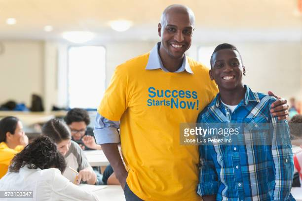 Volunteer mentor smiling with student