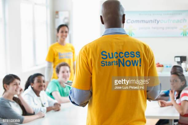 Volunteer mentor talking to students