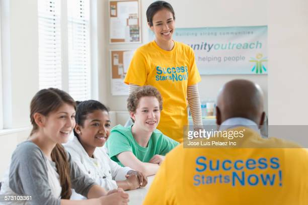 Volunteer mentors talking to students