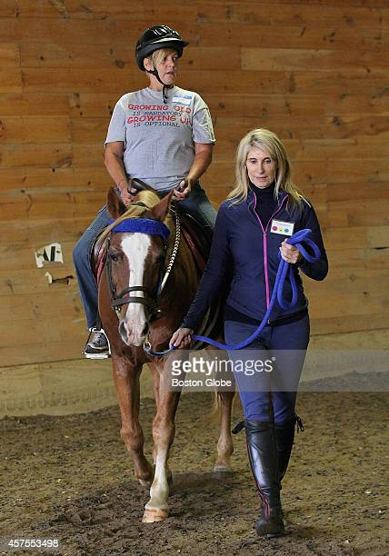 Volunteer Michele Neumeier led Karen Souza around an indoor track at BINA Farm Center in Norfolk Mass on October 7 2014