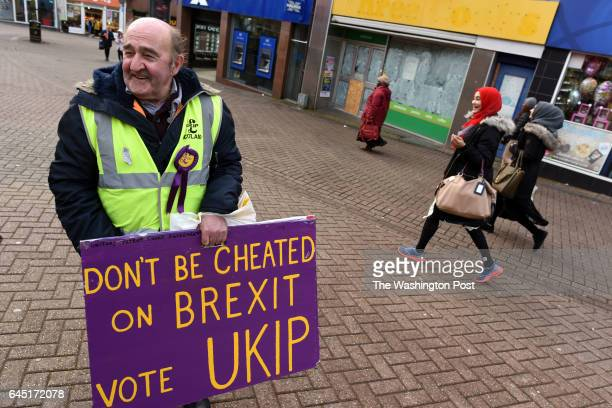 A volunteer Mr Murray from Scotland carries a sign in favor of the UKIP party in Stoke on Trent United Kingdom on February 22 2016 A crucial election...