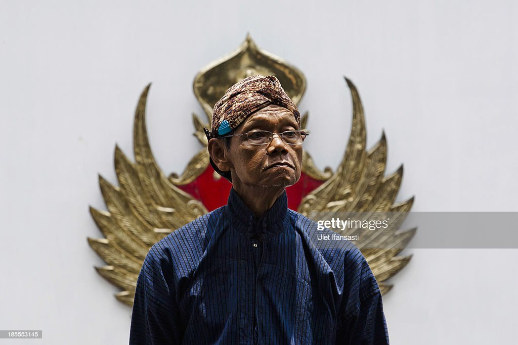 A volunteer of Kraton Palace, known as 'Abdi Dalem', attends the Royal Wedding Held For Sultan Hamengkubuwono X's Daughter Gusti Ratu Kanjeng Hayu And KPH Notonegoro on October 22, 2013 in Yogyakarta, Indonesia. Wedding celebrations will take place October 21-23 October. The wedding parade will include 12 royal horse drawn carriages and will be streamed live on the internet so that it can be watched by people all over the world.