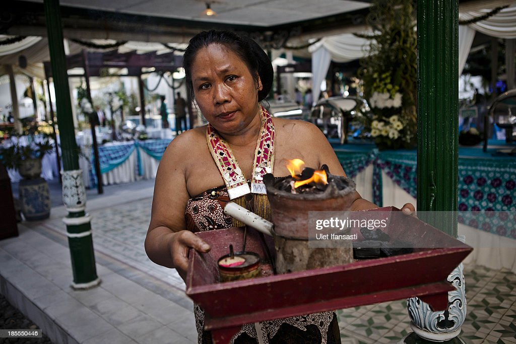 A volunteer of Kraton Palace, known as 'Abdi Dalem', carry offering before the wedding ceremony during the Royal Wedding Held For Sultan Hamengkubuwono X's Daughter Gusti Ratu Kanjeng Hayu And KPH Notonegoro on October 22, 2013 in Yogyakarta, Indonesia. Wedding celebrations will take place October 21-23 October. The wedding parade will include 12 royal horse drawn carriages and will be streamed live on the internet so that it can be watched by people all over the world.