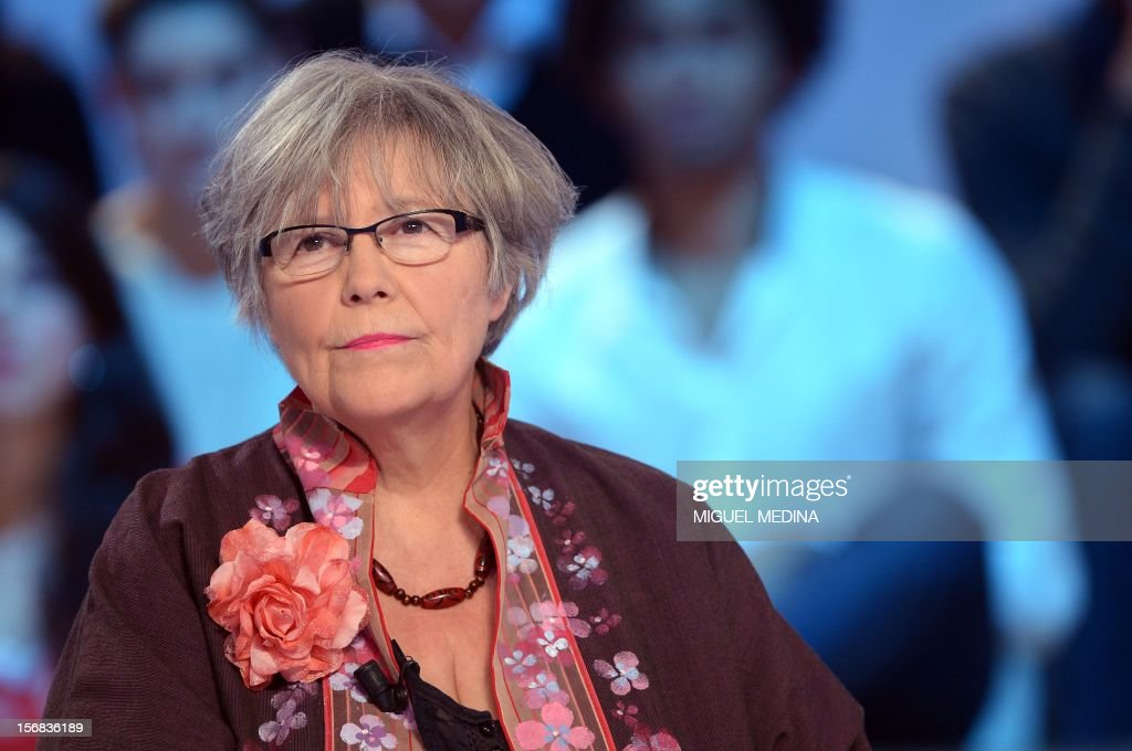 Volunteer of the 'Abbe Pierre' Foundation, Ghislaine Valadou takes part in the TV show 'Le grand journal' on a set of French TV Canal+, on November 22, 2012 in Paris. Former French football player turned actor Eric Cantona hosted the TV show 'Le grand journal', as part of the launching of French charity association Abbe Pierre Foundation's winter campaign. AFP PHOTO MIGUEL MEDINA