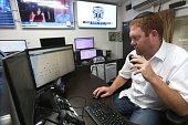 A volunteer of 'United Hatzalah' a network of volunteer medics across Israel monitors screens in the control room on June 14 2016 at the...