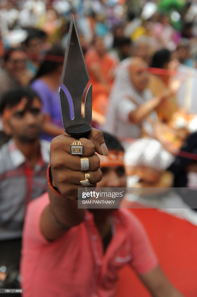 A volunteer of Vishwa Hindu Parishad (VHP) and Bajrang Dal displays a trishul or trident during the 'Hindu Ahead' Movement launch in Ahmedabad on March 31, 2013. Rashtriya Swayam Sewak (RSS) Chief, Mohan Ji Bhagwat inaugurated the 'Hindu Ahead' Movement in the presence of VHP International Working President, Pravin Togadia. 'Hindu Ahead' Movement was launched for the security and prosperity of the Hindus. AFP PHOTO / Sam PANTHAKY
