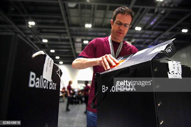 A volunteer opens a ballot box during counting for the London Mayoral election at the Excel centre in London UK on Friday May 6 2016 Sadiq Khan the...