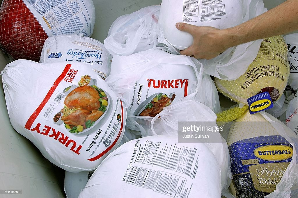 A volunteer prepares a box of turkeys to be given out during the 2006 holiday turkey distribution at the San Francisco Food Bank November 21 2006 in...