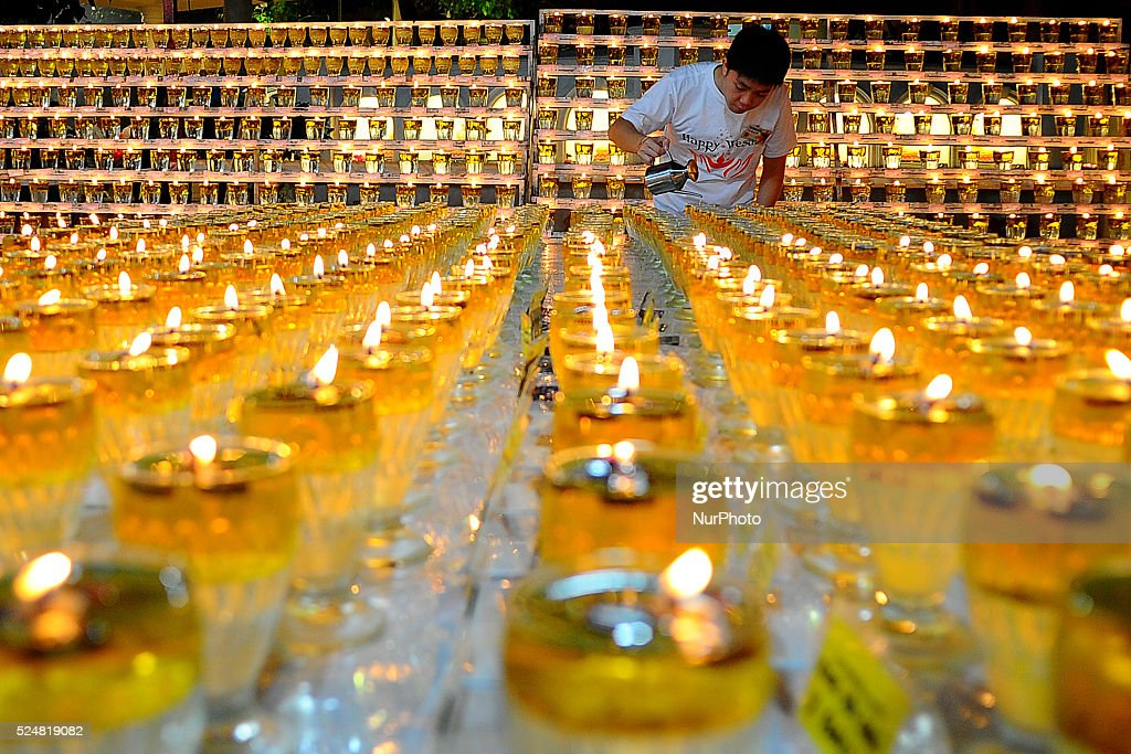 A volunteer prepares the lamp for prayers during the eve of Vesak Day at a temple in Kuala Lumpur Malaysia Monday May 12 2014 In Malaysia Buddha's...