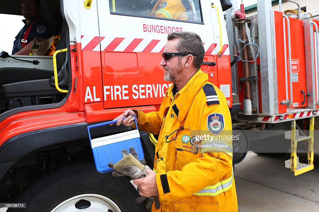 A volunteer Rural Fire Service member from Bungendore RFS responds to a fire at Mount Fairy on January 8, 2013 in Bungendore, Australia. NSW was declared a total fire ban with the Illawarra, Shoalhaven and Southern Ranges regions placed on 'Catastrophic' alert.