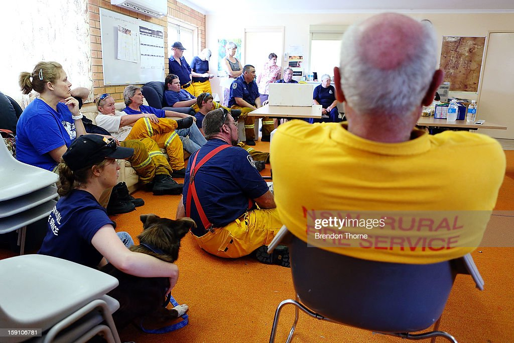 Volunteer Rural Fire Service members from Bungendore RFS debrief before attending a fire at Mount Fairy on January 8, 2013 in Bungendore, Australia. NSW was declared a total fire ban with the Illawarra, Shoalhaven and Southern Ranges regions placed on 'Catastrophic' alert.