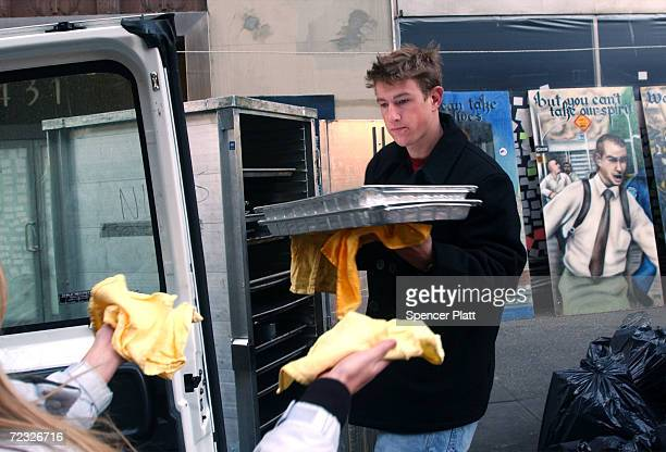 Volunteer Ryan Graves of San Diego helps to load food from Ninos restaurant into a van for delivery to Ground Zero workers February 8 2002 in New...