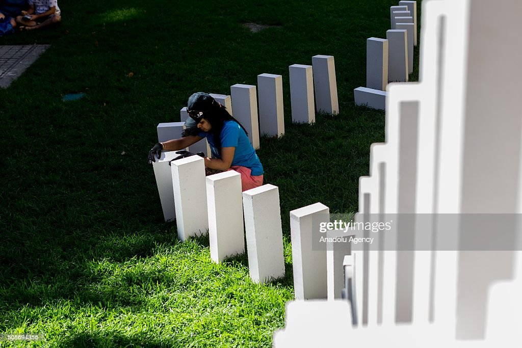A Volunteer setups a domino piece during the Arts Centre Melbournes Dominoes arts project in Melbourne, Australia February 6, 2016. More than 7000 giant dominoes snaked through Melbourne city over 2km.