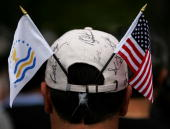 A volunteer shows hi support during the round 2 fourball matches of The Presidents Cup on September 28 at The Royal Montreal Golf Club in Montreal...