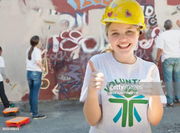Volunteer smiling in urban lot