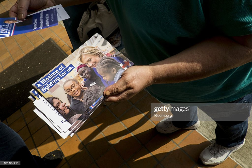 A volunteer sorts election pamphlets for Hillary Clinton former Secretary of State and 2016 Democratic presidential candidate outside of a polling...