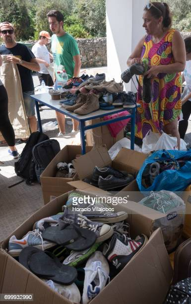 A volunteer sorts out shoes at the Santa Casa da Misericordia for the victims of the forest fire on June 22 2017 in Pedrogao Grande Portugal...
