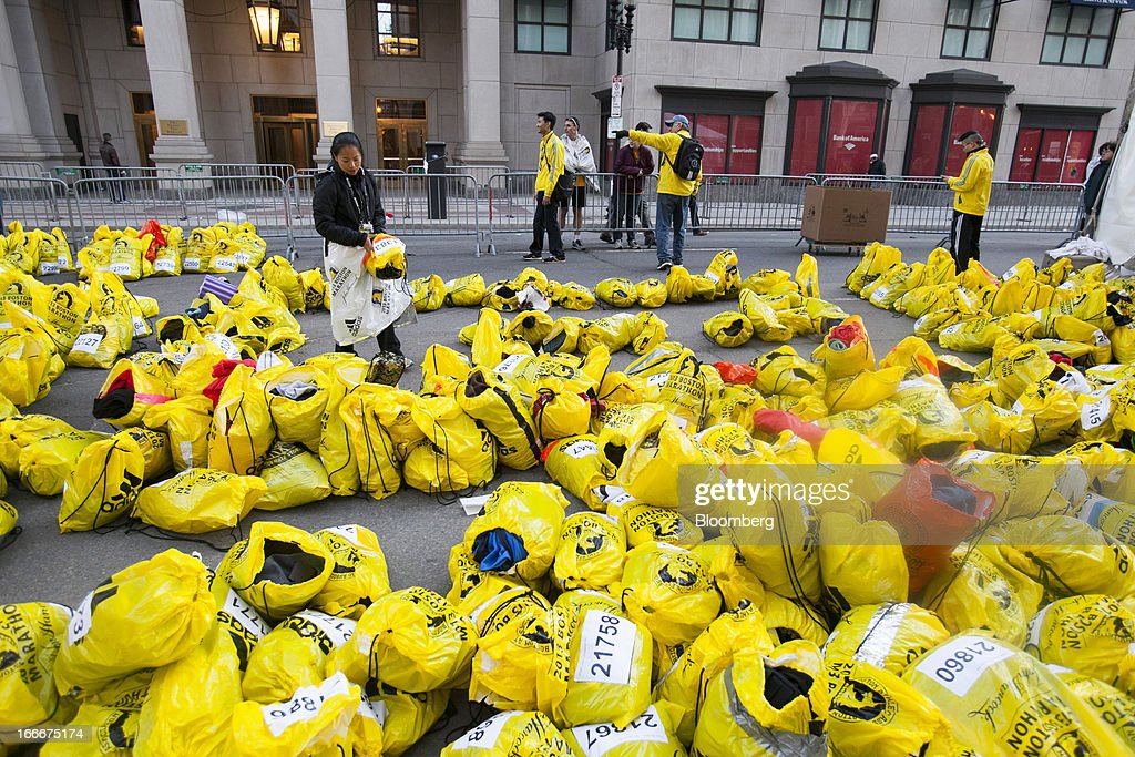 A volunteer sorts through unclaimed runners' bags after two explosions occurred along the final stretch of the Boston Marathon on Boylston Street in Boston, Massachusetts, U.S., on Monday, April 15, 2013. Powerful bombs killed two people and injured scores near the finish of the Boston Marathon, turning one of the world's oldest road races into bloody chaos. Photographer: Kelvin Ma/Bloomberg via Getty Images