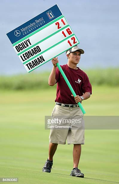 A volunteer standard bearer looks on during the final round of the MercedesBenz Championship at the Plantation Course on January 11 2009 in Kapalua...