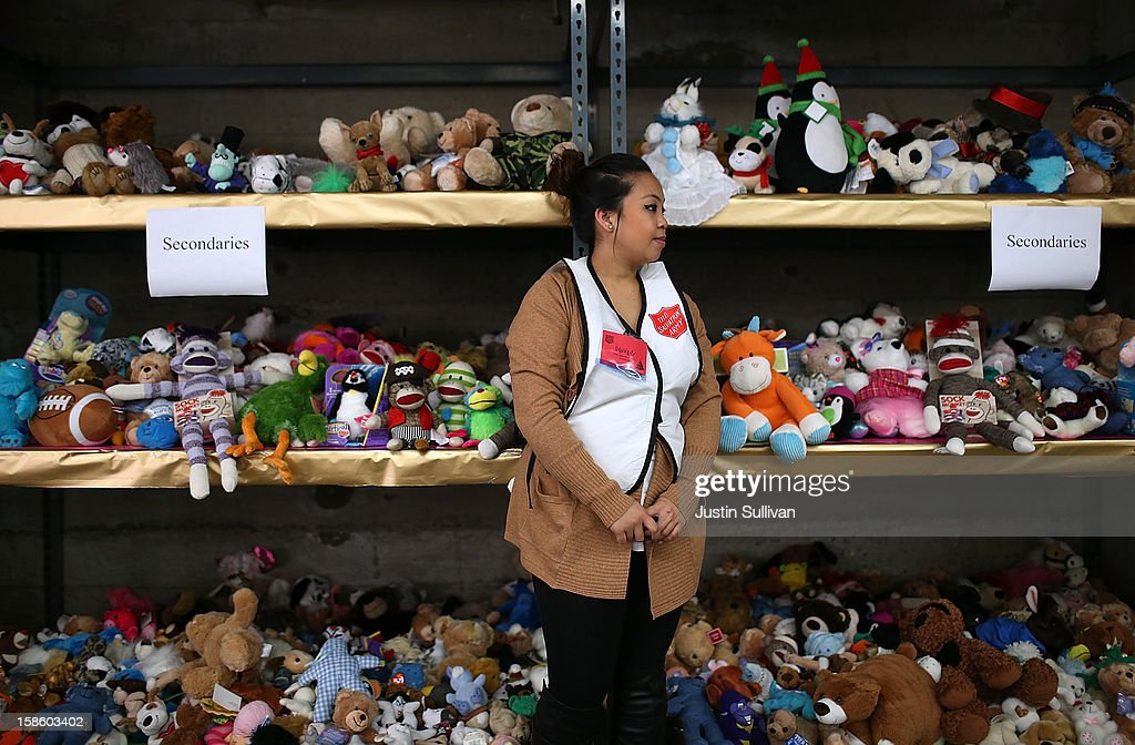 A volunteer stands next to a shelf filled with stuffed animals during the Salvation Army's Toy & Joy Shop Distribution on December 20, 2012 in San Francisco, California. With less than one week before Christmas, the Salvation Army's Golden State division held a Toy & Joy Shop Distribution event that allows families in need to shop for free toys and receive a bag with ingredients to make a holiday meal. Nearly 1,500 families will attend the two day event.